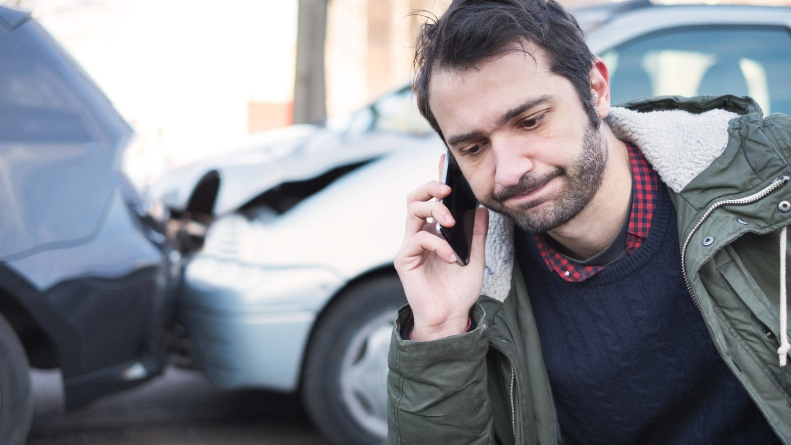 man call insurance company after an accident