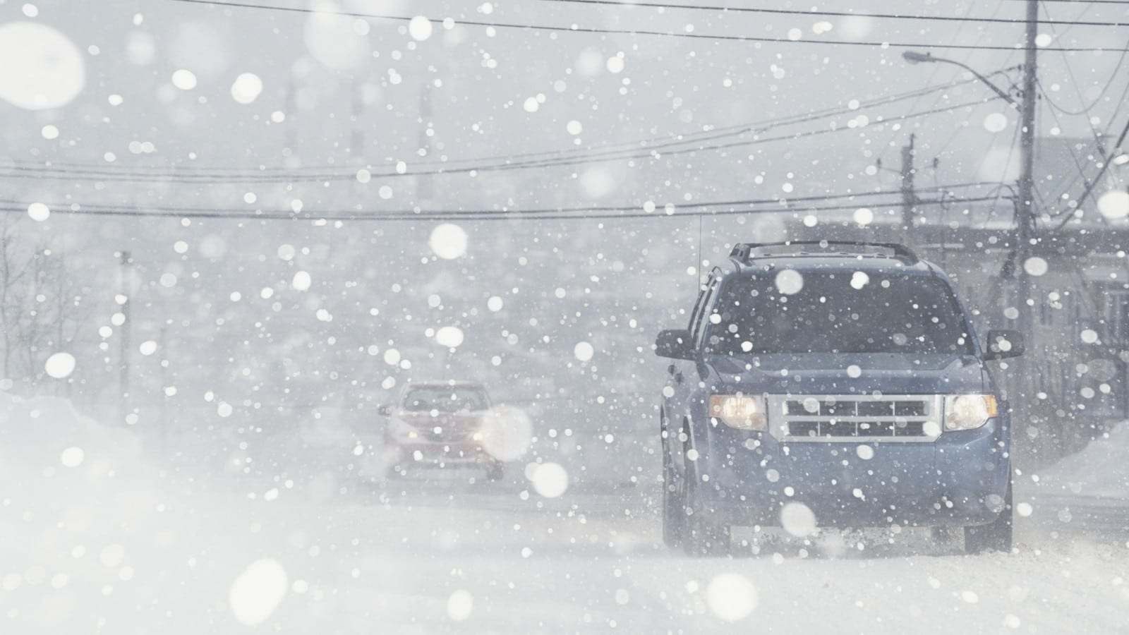 Cars Driving During The Snow Stock Photo