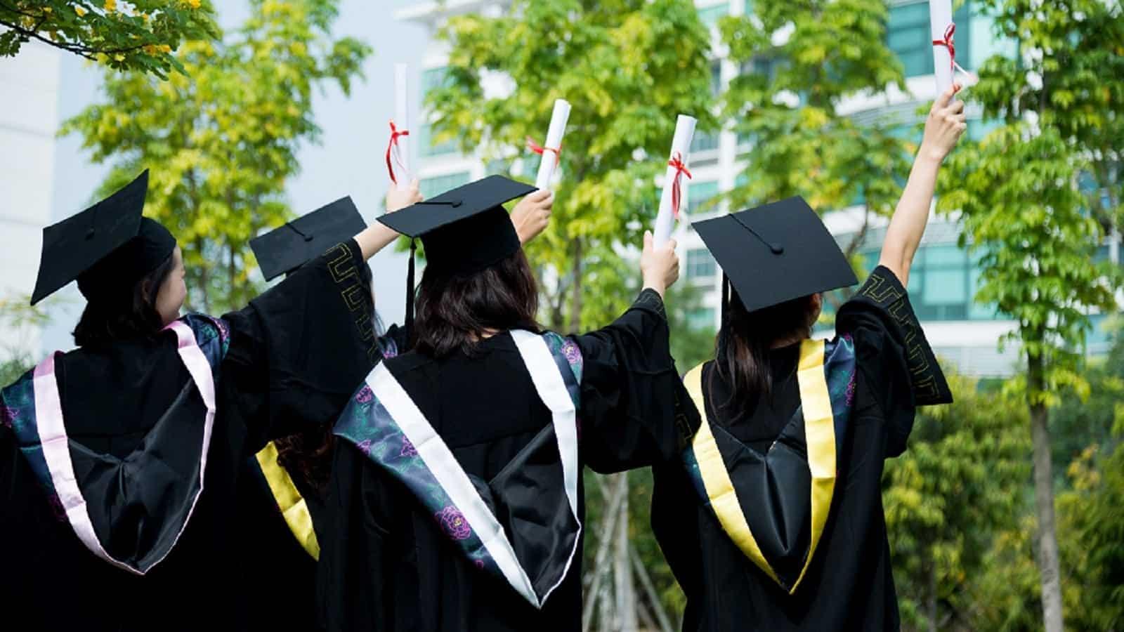 Peter N. Davis Scholarship, Graduates holding up Diplomas