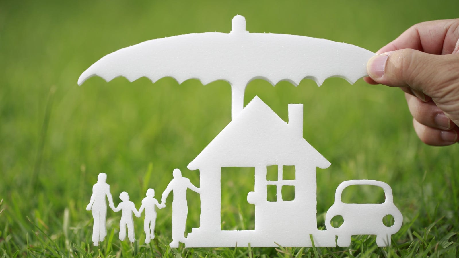 Umbrella Protecting Home Stock Photo