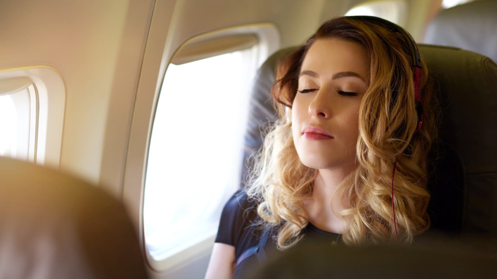 Young Woman On A Flight Stock Photo