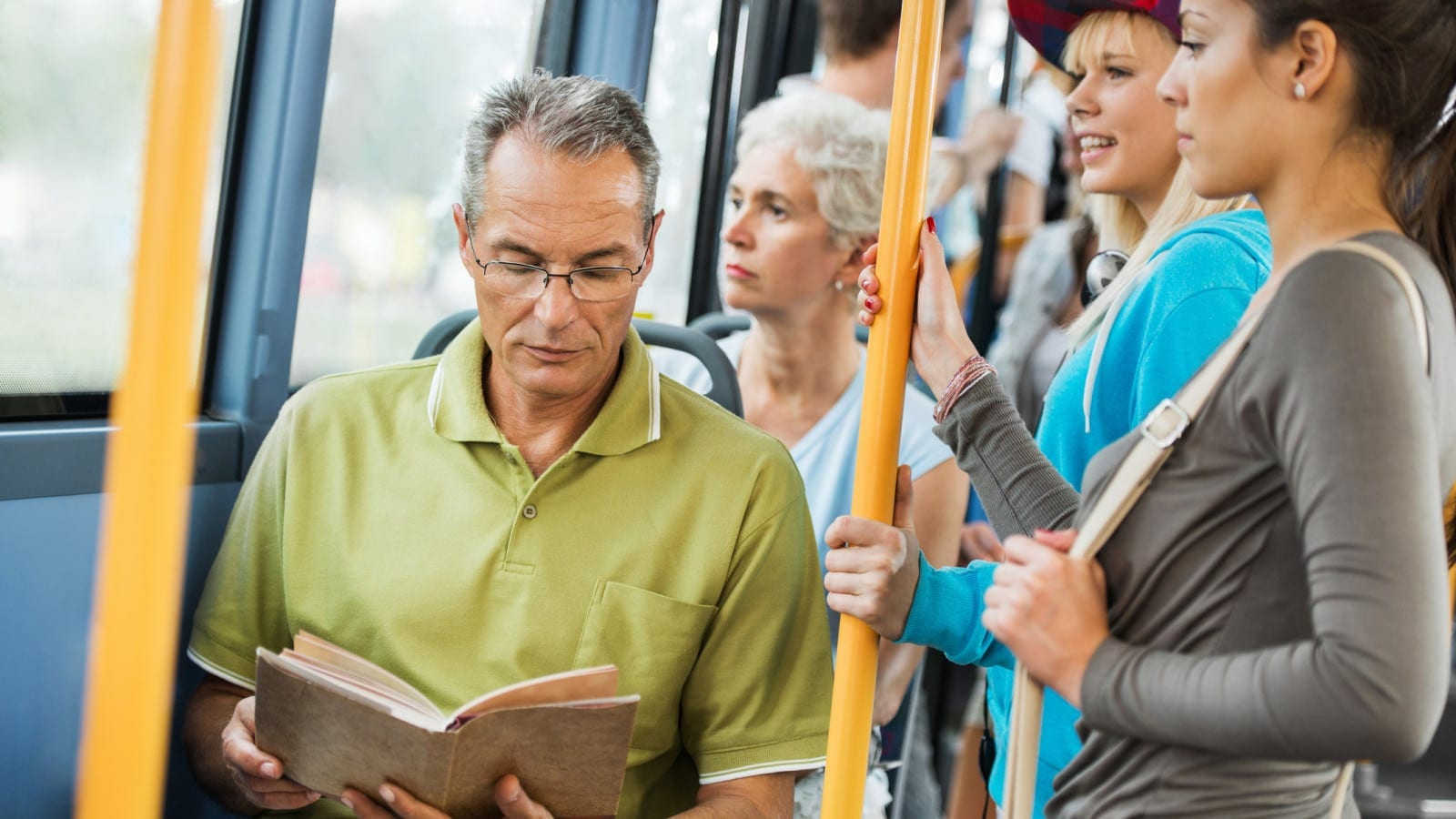 Senior Man Reading On A Bus Stock Photo