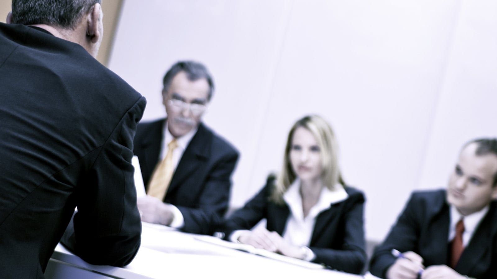 Personal injury lawyer mediating a claim at a meeting.