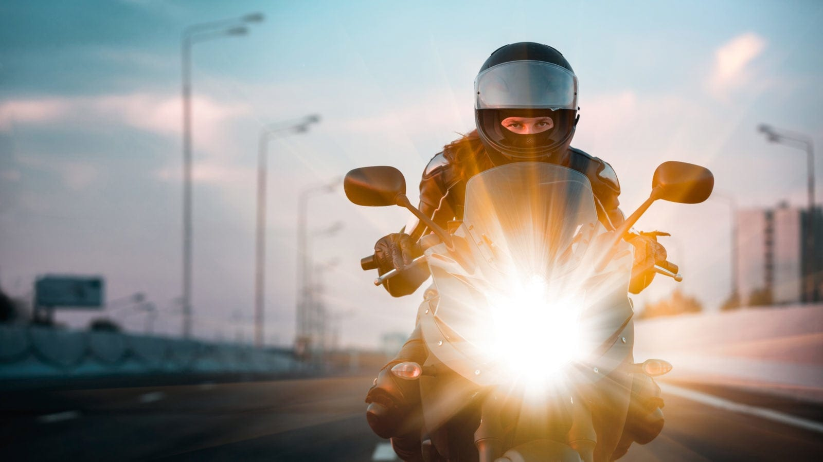 Woman Riding A Motorcycle Stock Photo