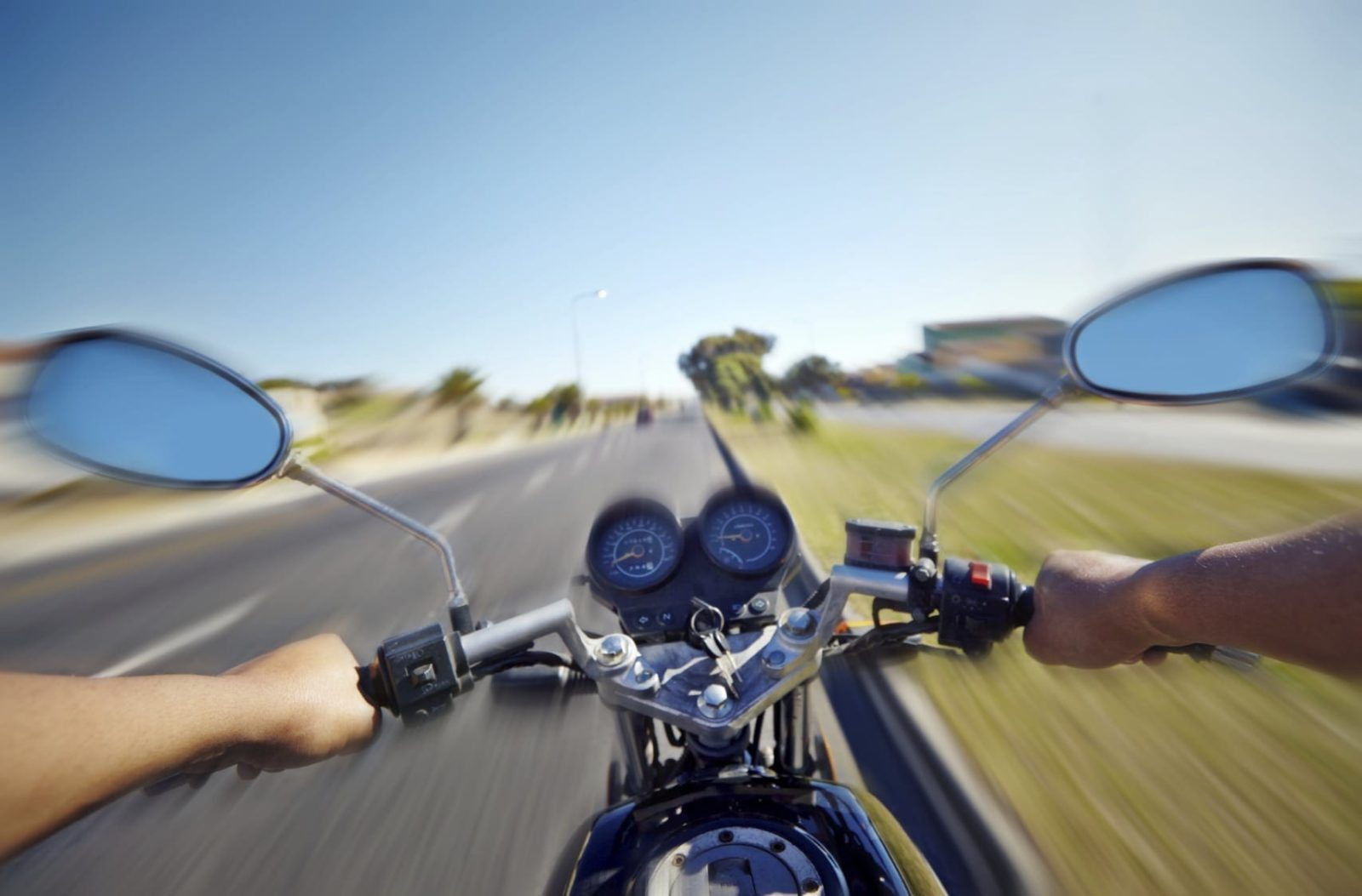 Man Riding Motorcycle On The Highway Stock Photo