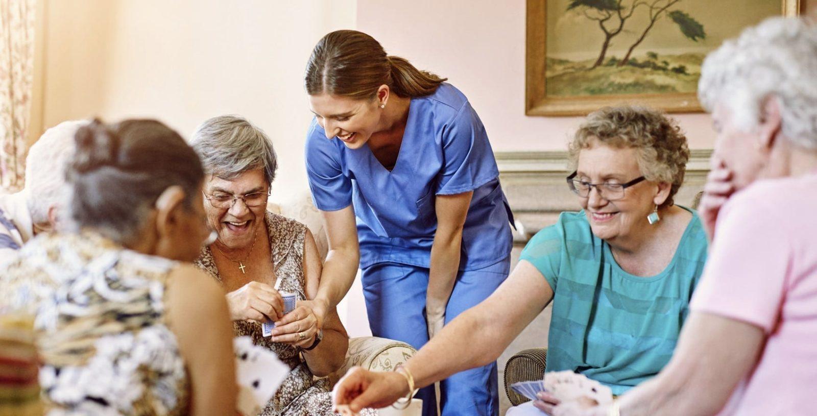 Elderly Women Playing Cards Stock Photo