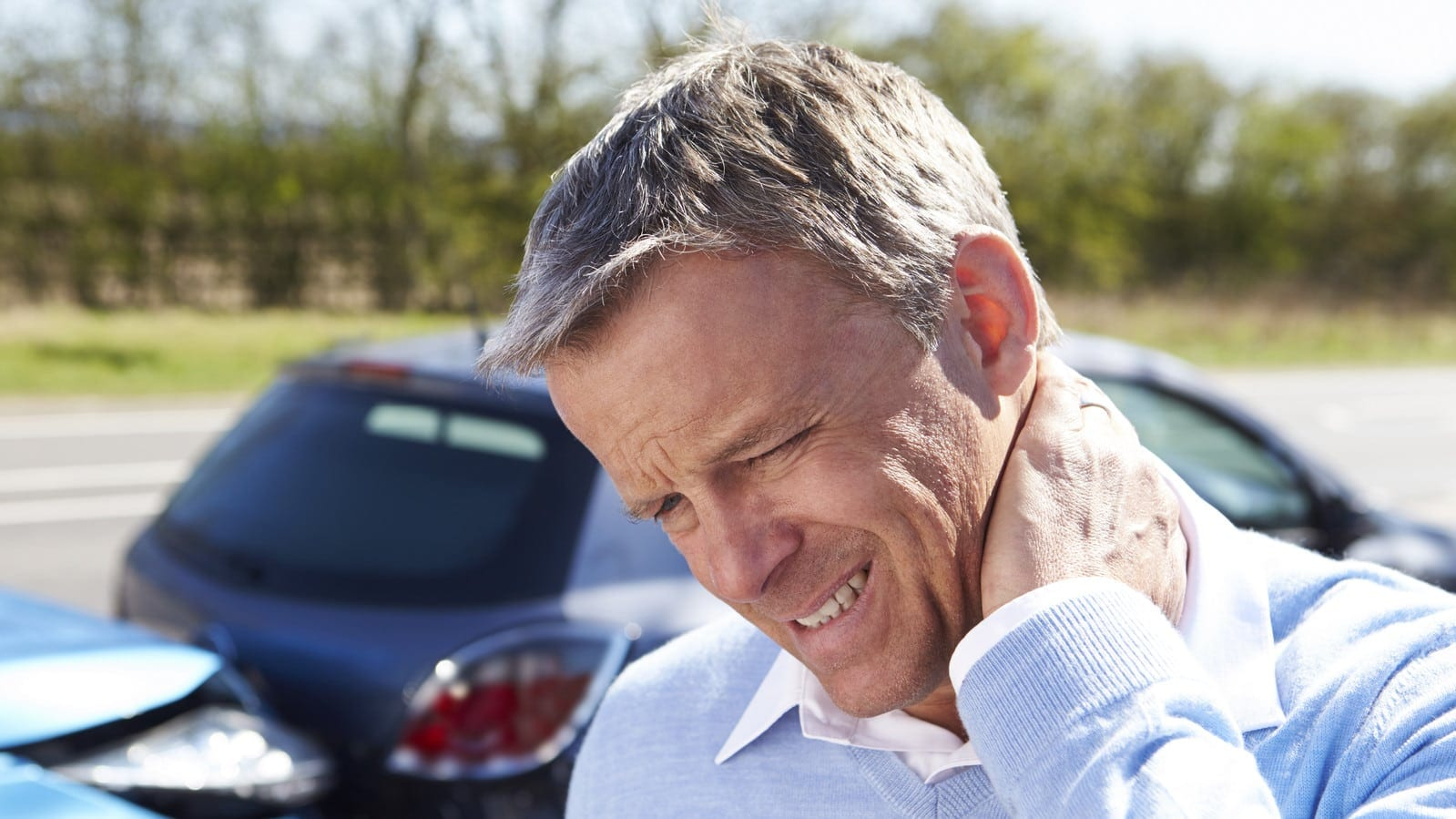 Man With A Whiplash Injury Stock Photo