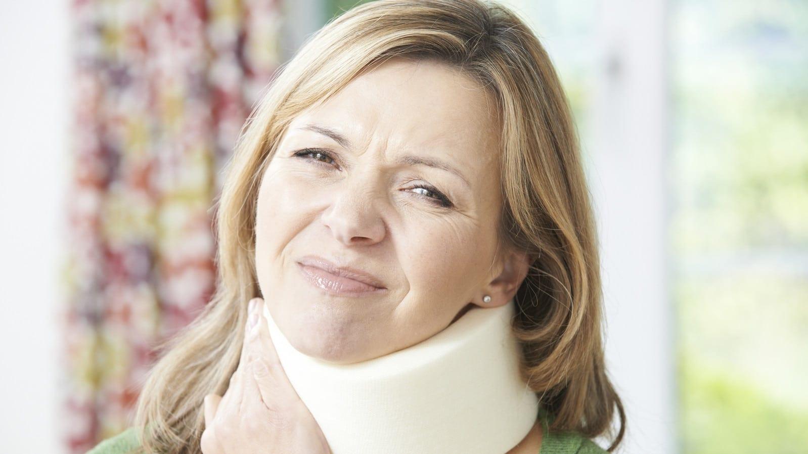 Woman In A Neck Brace Stock Photo