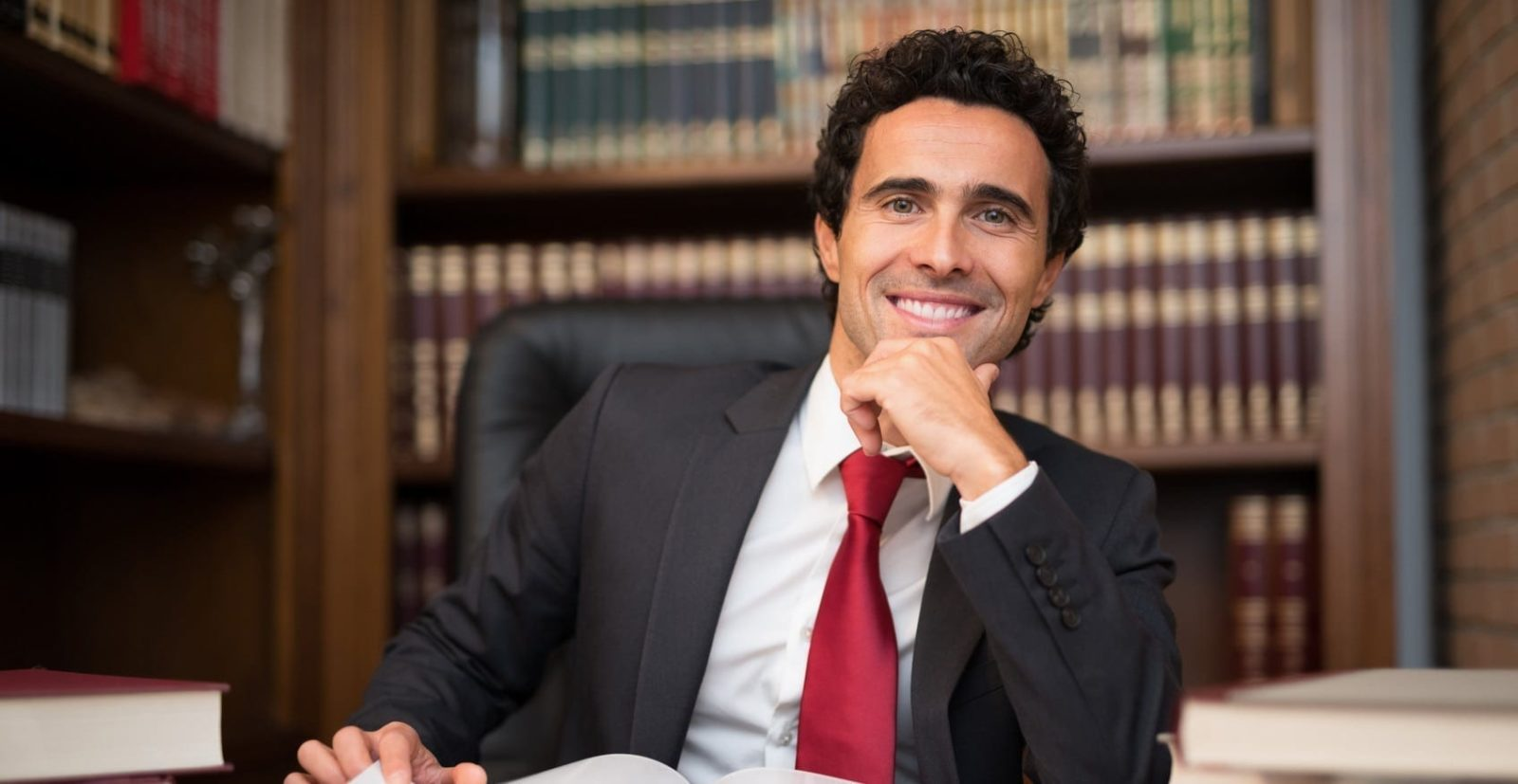 Attorney Smiling In His Office Stock Photo