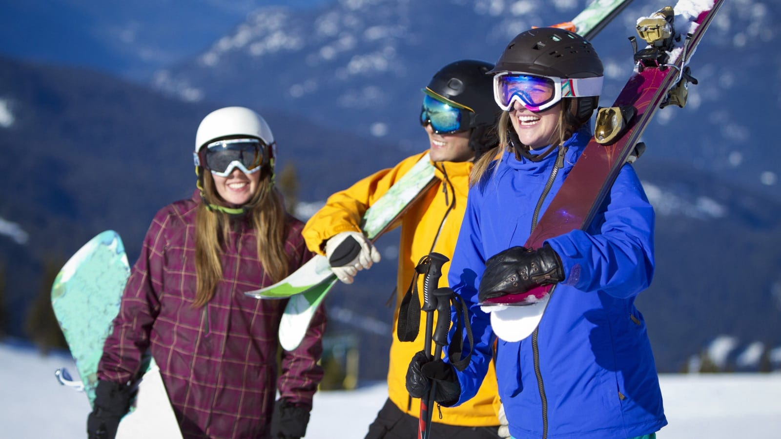 Friends Skiing And Snowboarding Stock Photo