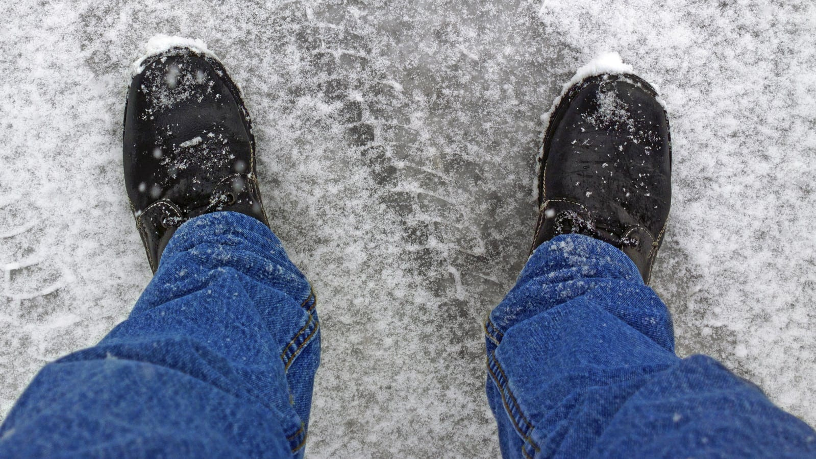 Man In Work Boots Walking In The Snow Stock Photo