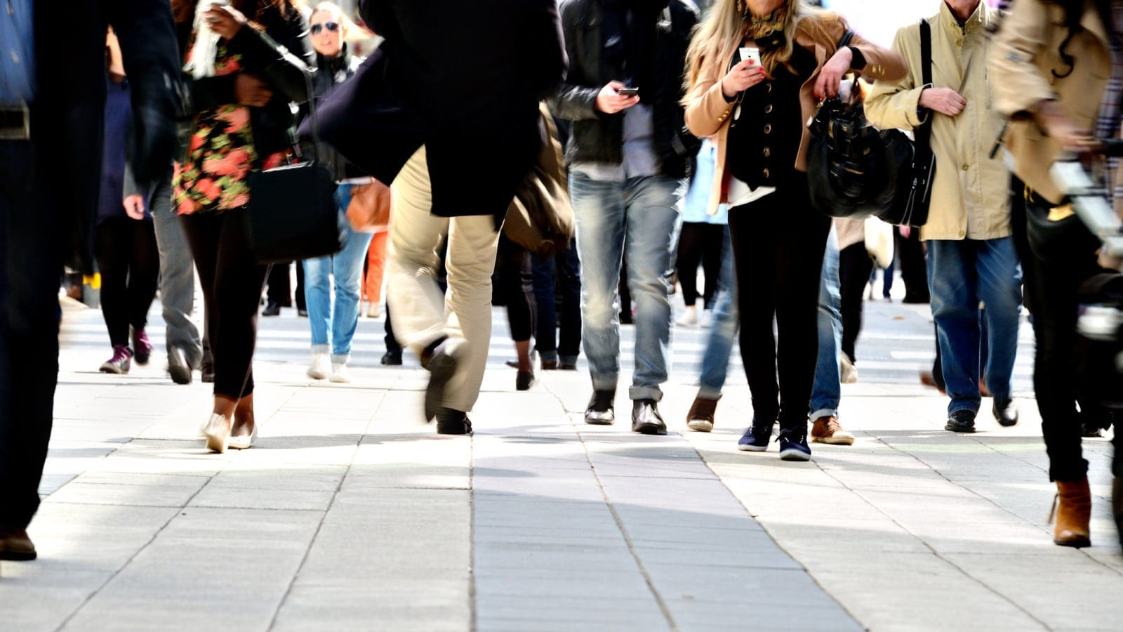 Pedestrians Walking On A Sidewalk Stock Photo