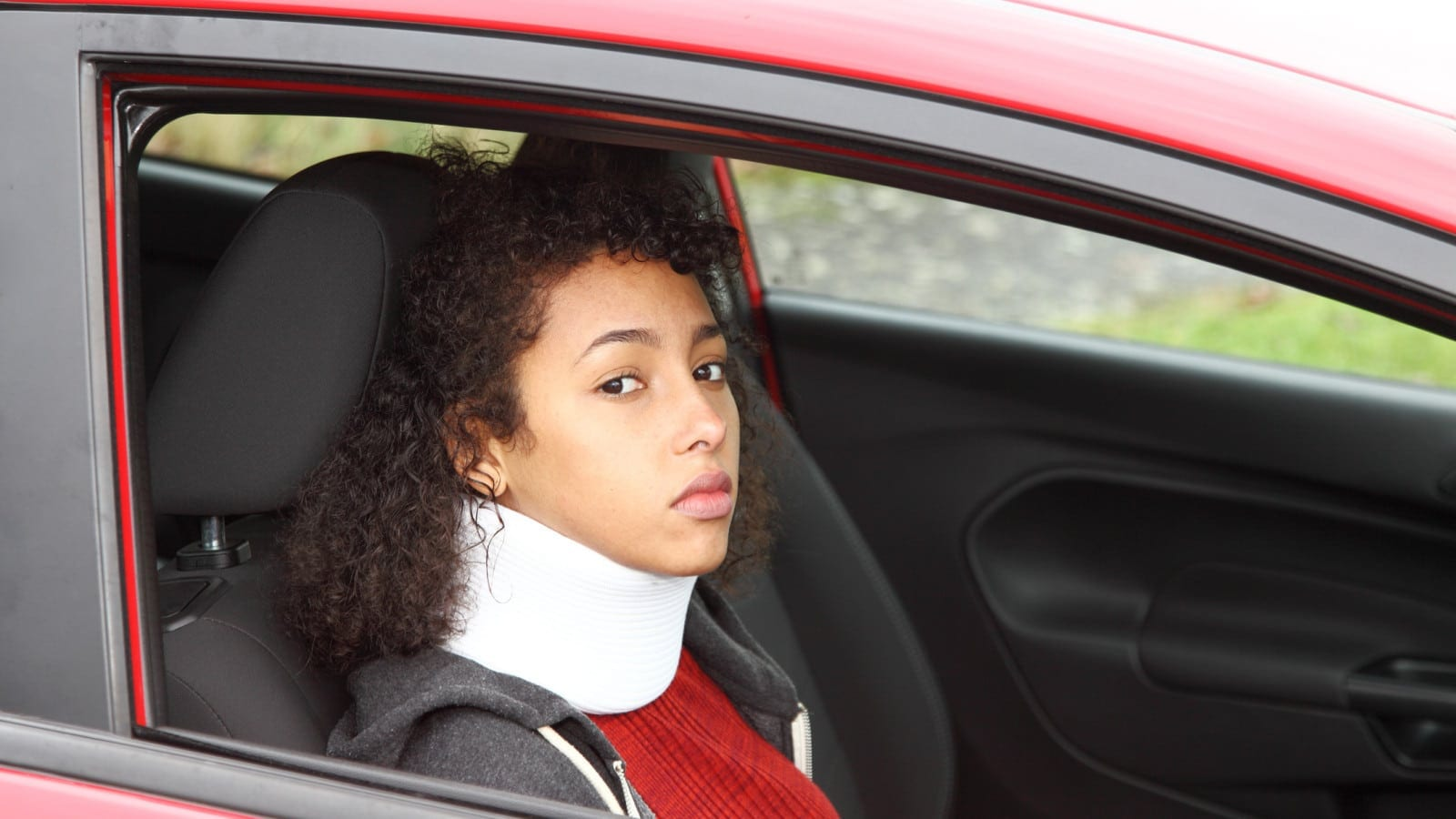 Young Woman In A Neck Brace Stock Photo