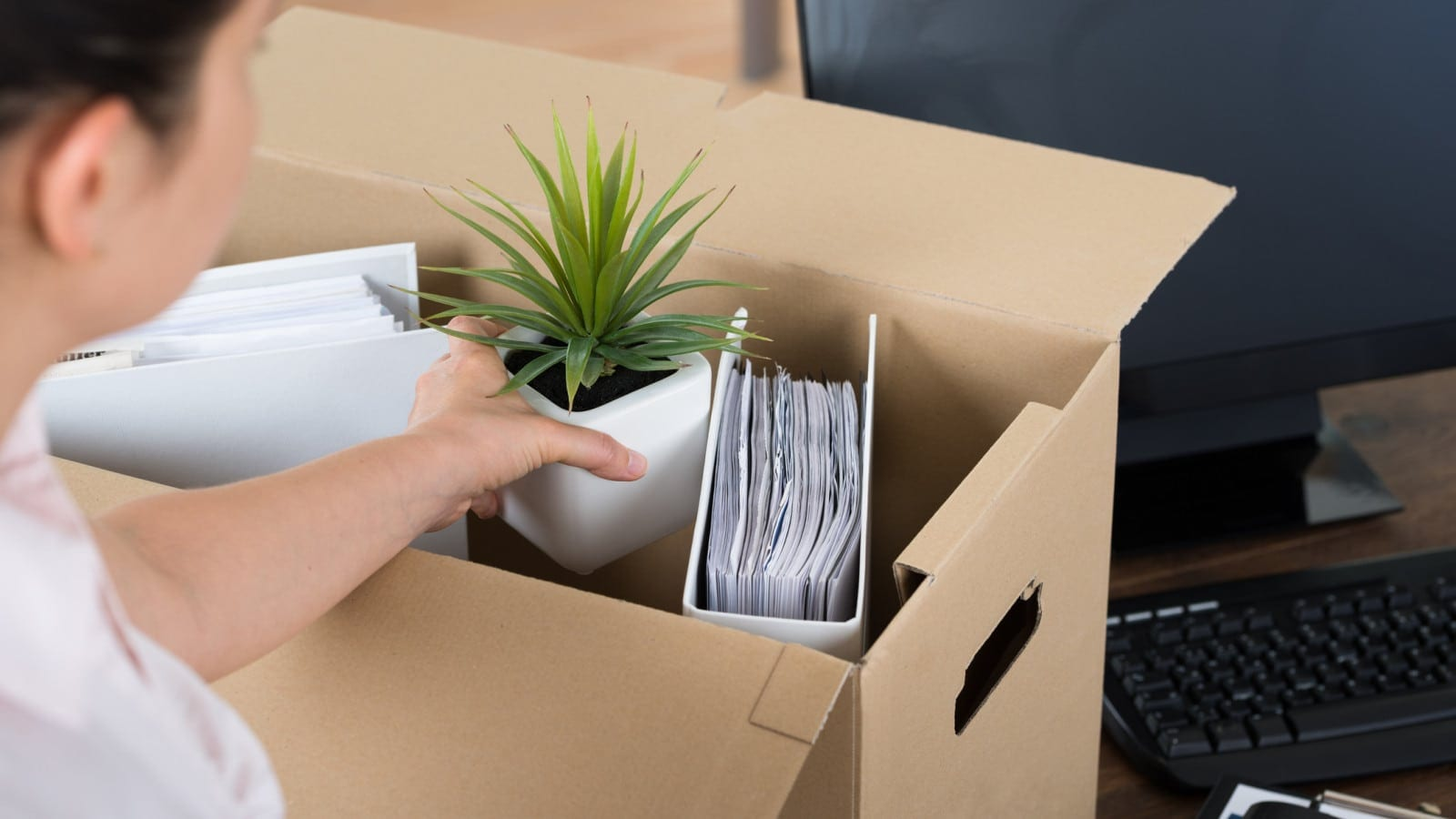 Businesswoman Packing Her Belongings Stock Photo