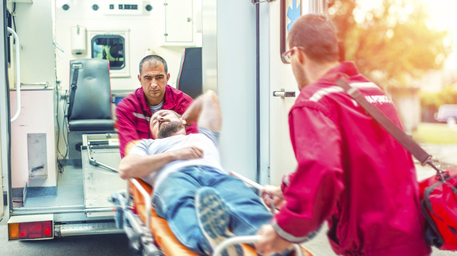 Paramedics Helping Patient On A Stretcher Stock Photo