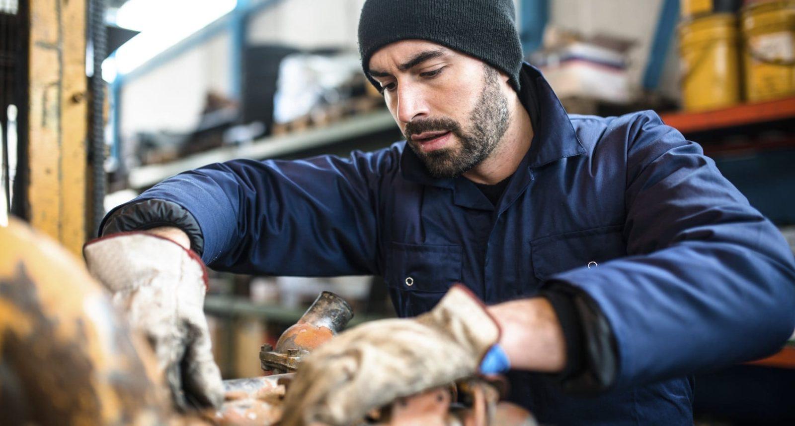 Mechanic Working In An Auto Body Shop Stock Photo