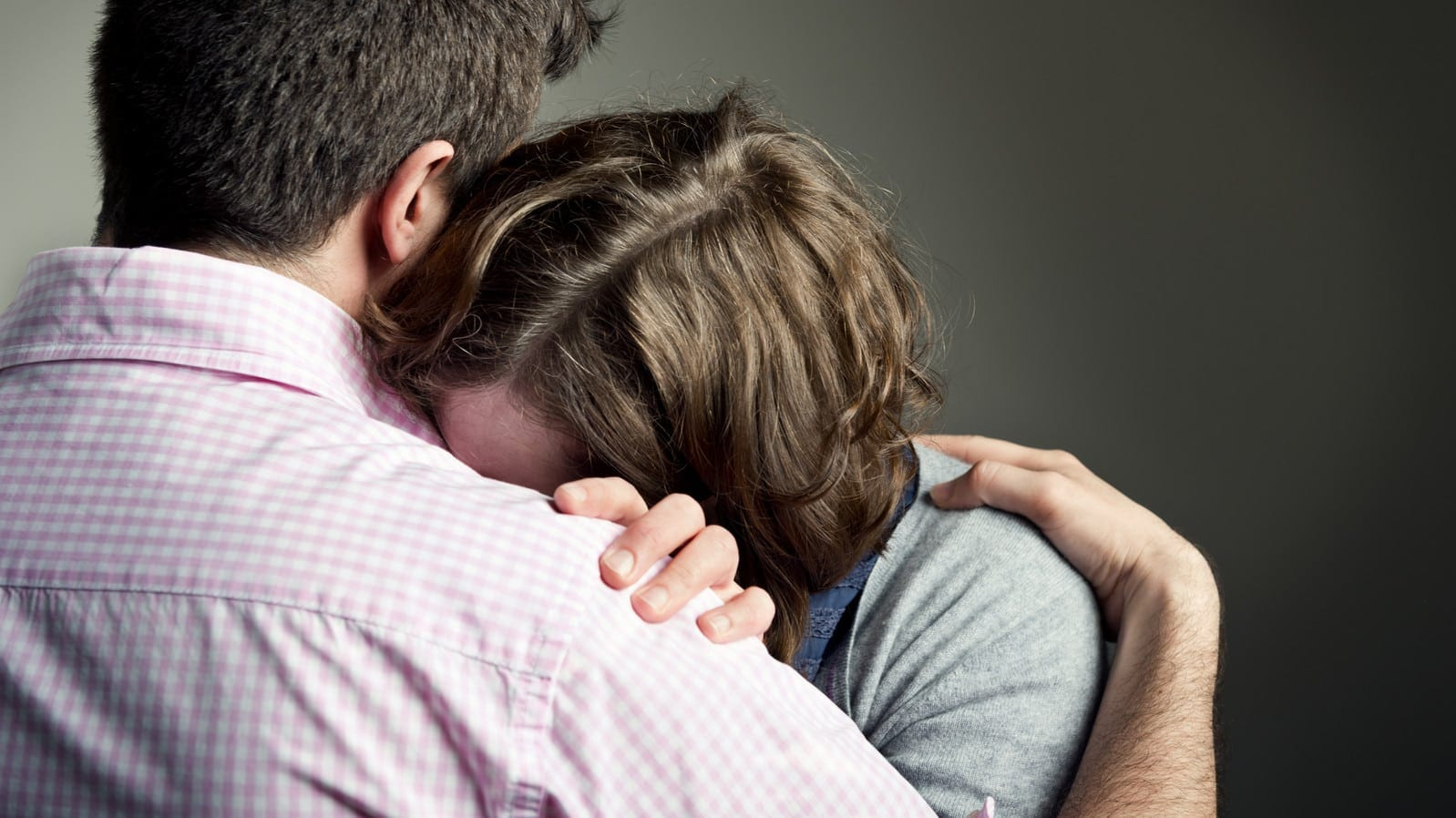 Husband Consoling Wife Stock Photo