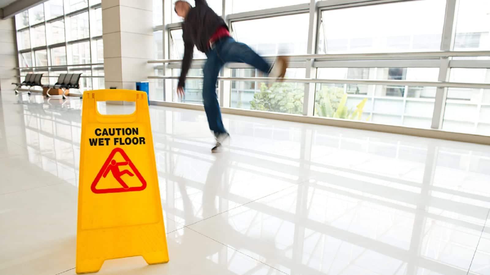 Man Slipping On Wet Floor Stock Photo