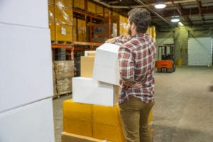 warehouse-worker-experiencing-back-pain