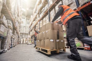 warehouse-worker-moving-boxes