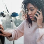 woman calling a car accident lawyer after an accident