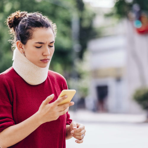 A woman wearing a neck brace after a personal injury in Paterson, NJ