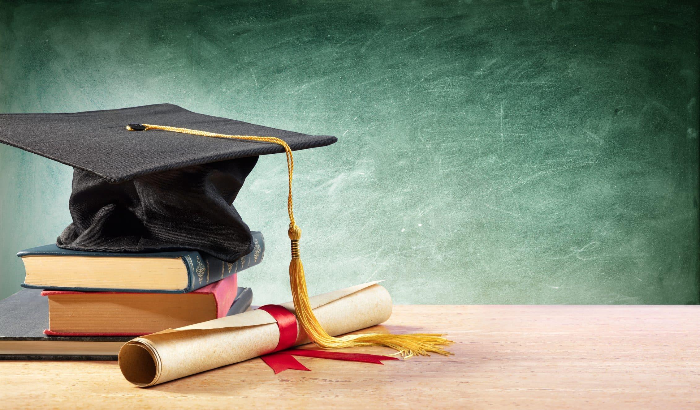 A graduation cap and diploma.
